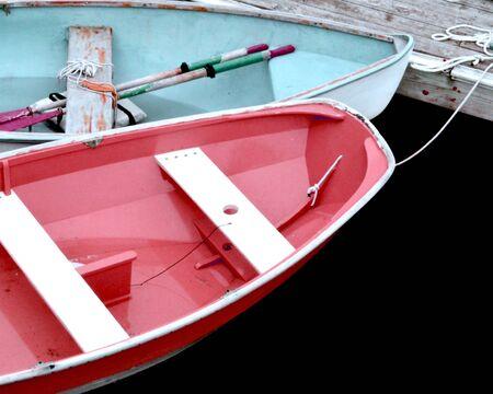 deportes nauticos: Botes de remos atados a un muelle