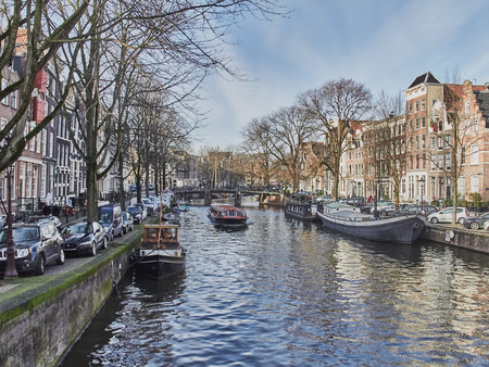 Amsterdam cityscape in January with canals and pleasure boats.