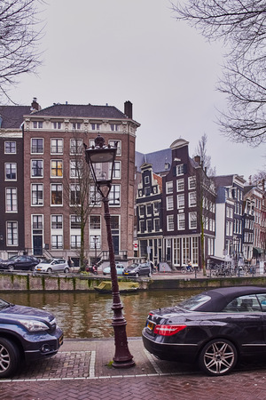 Amsterdam cityscape in the month of January with canals and leaning old houses Banco de Imagens