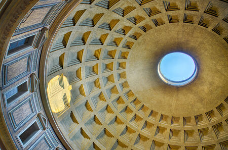Roman Pantheon with blue sky and sun reflection from cupola hole