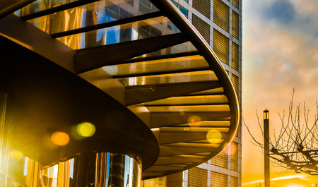 Arch canopy of modern building at colorful sunset, The Hague, Netherlands photo