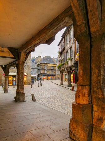 dinan: Center of medieval city Dinan, seen from between old wooden pillars, France