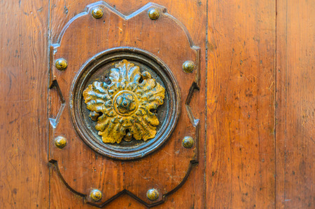 Old decorative element on a wooden door in Venice Italy