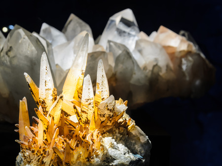 Raw crystals of quartz in yellow golden color in black background