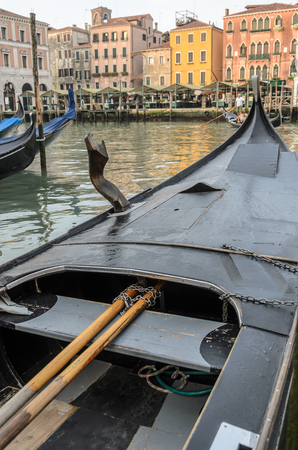Gondola on the grand canal, close up, inside, with yellow, orange buildings across grand canal Banque d'images