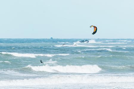 Kite surfing in big splashy  waves on windy weather