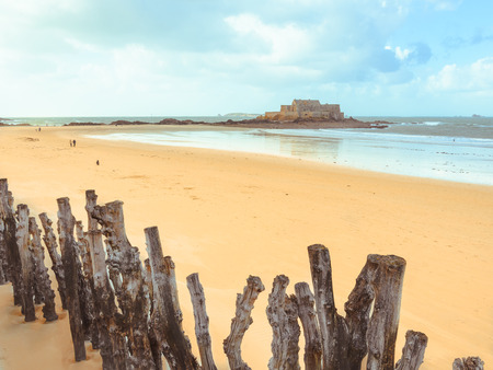 Low tide on seashore Saint-Malo and Fort National Brittany, France