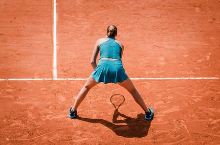Back view  of a woman playing tennis, waiting to play the outdoor competition game as professional player Banco de Imagens