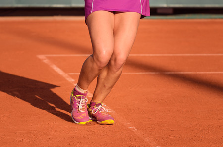 Feet of a male tennis player in jump after shot, service