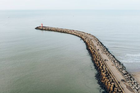 Aerial view of one pier and lighthouse in harbour of Scheveningen, The Hague