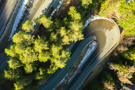 Aerial view of a car serpentine on a mountain. Road to La Thuile village and ski area. Mountain serpentine in Aosta valley in Italy. Banque d'images