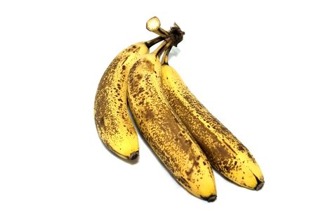 overripe: Overripe bananas isolated on white.