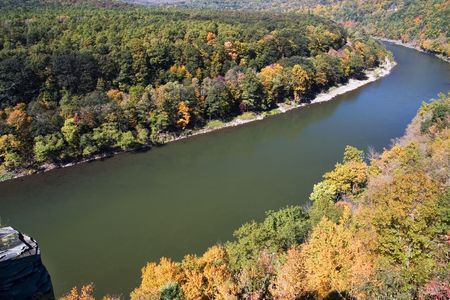 Delaware river makes turn with autumn landscape