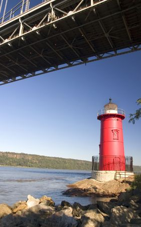 The Little Red Lighthouse under GWB in New York, on the Hudson River.