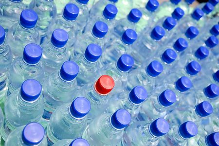 Drinking water in the plastic bottles. photo