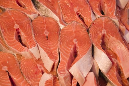 Fresh cuts of salmon as a background