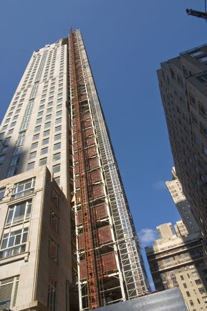 Construction of new skyscraper against a deep blue sky