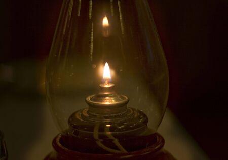 Old fashion oil lamp in the dark room.