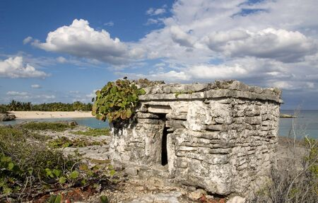 riviera maya: Ancient Mayan fort on the coast of Riviera Maya, Mexico. Stock Photo
