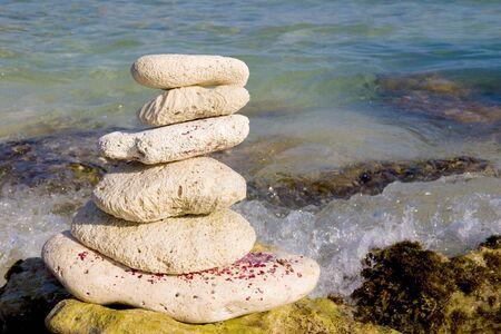 Zen like stack of stones on the sea shore.
