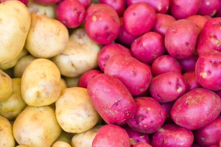 starchy food: White and red potatoes on the street market