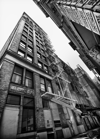 Perspective view of NYC building exterior with fireescape, Black and white. Stock Photo