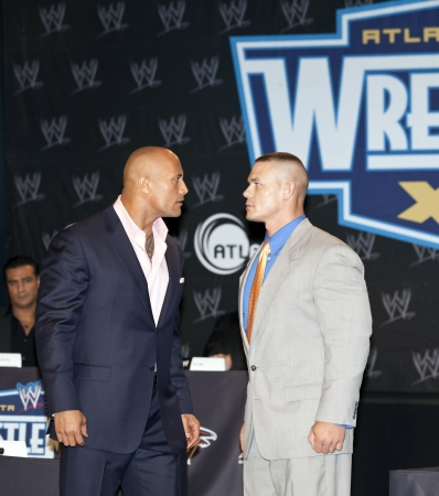 NEW YORK, NY - MARCH 30: Pro wrestler Dwayne The Rock Johnson (L) and pro wrestler John Cena attend the WrestleMania XXVII press conference at Hard Rock Cafe New York on March 30, 2011 in New York City.