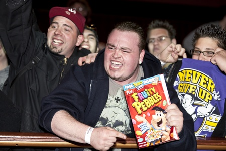 NEW YORK, NY - MARCH 30: Unidentified  fans cheer up WWE Superstars during  the WrestleMania XXVII press conference at Hard Rock Cafe New York on March 30, 2011 in New York City.