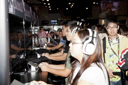 computer games: NEW YORK, NY - OCTOBER 14: Unidentified convention goers play computer games on convention floor 2011 New York Comic Con at the Jacob Javits Center on October 14, 2011 in New York City. Editorial