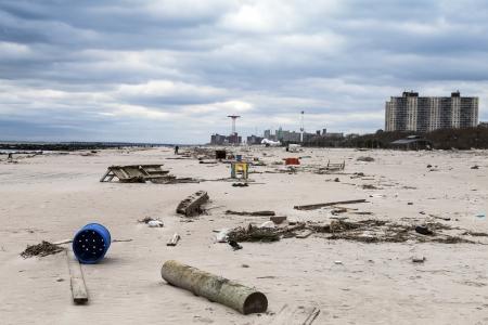 the aftermath: NEW YORK - NOVEMBER 1, 2012  Debris on the Brighton Beach after Hurricane Sandy hit Brooklyn area on November 1, 2012, Brooklyn, NY