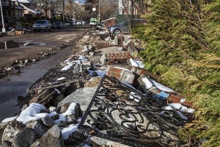 hurricane sandy: NEW YORK - NOVEMBER 8, 2012: Debris and broken fence near flooded and damaged house after Hurricane Sandy  on Manhattan Beach on November 8, 2012, Brooklyn, NY Editorial