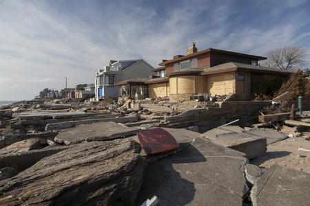 hurricane sandy: NEW YORK - NOVEMBER 12, 2012:Pile of garbage, debris near flooded and damaged house after Hurricane Sandy  on Manhattan Beach on November 12, 2012, Brooklyn, NY Editorial