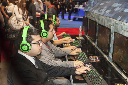 NEW YORK - October 13  Fans try new game   Dungeon Defenders II  during Comic Con 2013 at The Jacob K  Javits Convention Center on October 13, 2013 in New York City  Stock Photo - 22771626