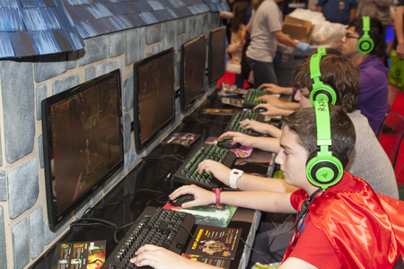 NEW YORK - October 13  Fans try new game   Dungeon Defenders II  during Comic Con 2013 at The Jacob K  Javits Convention Center on October 13, 2013 in New York City  Stock Photo - 22771377