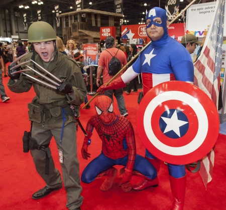 spider man: NEW YORK - October 13  Comic Con attendees posing in the costume during Comic Con 2013 at The Jacob K  Javits Convention Center on October 13, 2013 in New York City  Editorial