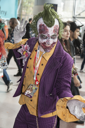 NEW YORK - October 13  Comic Con attendee poses in the costume of Joker during Comic Con 2013 at The Jacob K  Javits Convention Center on October 13, 2013 in New York City  Stock Photo - 22771634