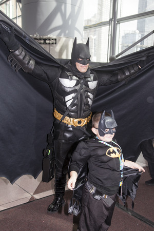 NEW YORK - October 13  Comic Con attendees posing in the costume of Batman during Comic Con 2013 at The Jacob K  Javits Convention Center on October 13, 2013 in New York City  Stock Photo - 22771636