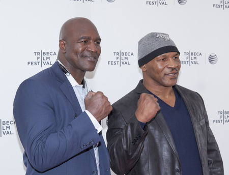 New York, NY, USA - April 19, 2014: Professional Boxers Mike Tyson and Evander Holyfield attend Tribeca Talks: After the Movie: Champs during the 2014 Tribeca Film Festival at the SVA Theater, Manhattan