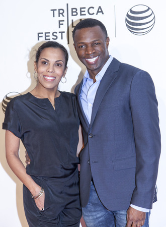 laurent: New York, NY, USA - April 21, 2014: Actor Sean Patrick Thomas (R) and Aonika Laurent attend Tribeca Talks: After The Movie: NOW: In the Wings On A World Stage during the 2014 Tribeca Film Festival at BMCC Tribeca PAC, Manhattan Editorial