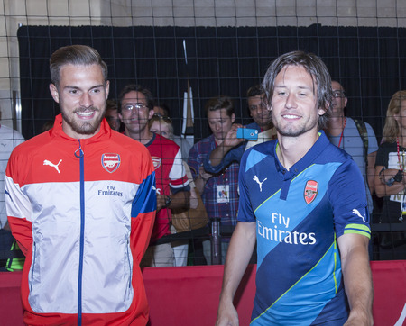 New York, NY, USA - July 25, 2014   L-R  Footballers Aaron Ramsey and Tomas Rosicky greet fans the PUMA partners with Arsenal Football Club to Debut Monumental Cannon event in Grand Central Station in New York City  Imagens - 30230616