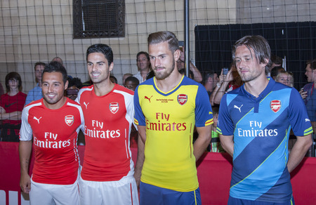 New York, NY, USA - July 25, 2014   L-R  Footballers Santi Cazorla, Mikel Arteta, and Tomas Rosicky greet fans at the PUMA partners with Arsenal Football Club to Debut Monumental Cannon event in Grand Central Station in New York City  報道画像