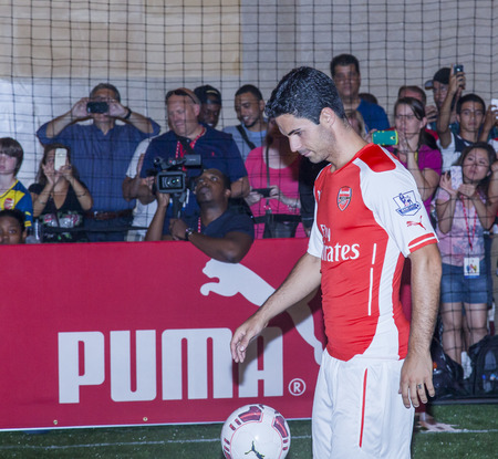 New York, NY, USA - July 25, 2014  Arsenal foofball player Mikel Arteta attends the PUMA partners with Arsenal Football Club to Debut Monumental Cannon event in Grand Central Station in New York City  Imagens - 30230623