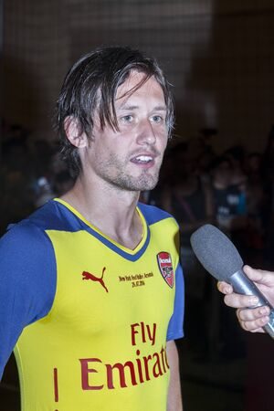 arsenal: New York, NY, USA - July 25, 2014  Arsenal football player Tomas Rosisky attends the PUMA partners with Arsenal Football Club to Debut Monumental Cannon in Grand Central Station in New York City