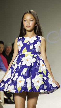 aria: New York, NY, USA - October 19, 2014: A model walks the runway during the Aria Childrens Clothing preview at petitePARADE  Kids Fashion Week at Bathhouse Studios, Manhattan
