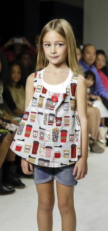 badhuis: New York, NY, USA - October 19, 2014: A model walks the runway during the Aria Childrens Clothing preview at petitePARADE  Kids Fashion Week at Bathhouse Studios, Manhattan