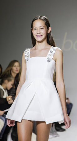 bonnie: New York, NY, USA - October 19, 2014: A model walks the runway during the Bonnie Young preview at petitePARADE  Kids Fashion Week at Bathhouse Studios, Manhattan