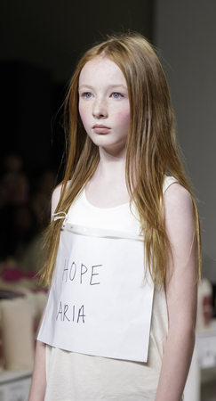 aria: New York, NY, USA - October 19, 2014: A model walks the runway rehearsal during the Aria Childrens Clothing collection preview at petitePARADEKids Fashion Week at Bathhouse Studios, Manhattan Editorial