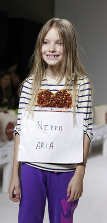New York, NY, USA - October 19, 2014: A model walks the runway rehearsal during the Aria Childrens Clothing collection preview at petitePARADEKids Fashion Week at Bathhouse Studios, Manhattan Editorial