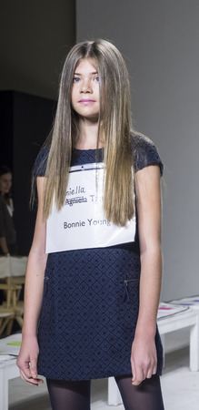 bonnie: New York, NY, USA - October 19, 2014: A model walks the runway rehearsal during the Bonnie Young collection preview at petitePARADEKids Fashion Week at Bathhouse Studios, Manhattan Editorial