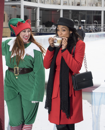 nescafe: New York, NY, USA - December 2, 2014:  Actress Rosario Dawson kicks off Operation Give With Gusto in New York with NESCAFE Dolce Gusto and 100 Holiday Elves at Bryant Park, Manhattan Editorial